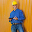 Stock Photo: Male Architect Holding Digital Tablet Against Trailer