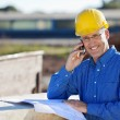 Smiling Architect Using Mobile Phone At Site — Stock Photo