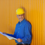 Architect Wearing Hardhat With Blue Print — Stock Photo