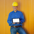 Stock Photo: Male Architect Showing Digital Tablet Against Trailer