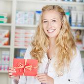 Pharmacist With Bonus Coupon Card Gift — Stock Photo
