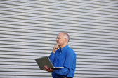 Thoughtful Businessman With Laptop While Looking Away — Stock Photo