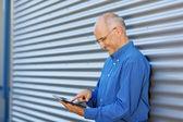 Businessman Using Digital Tablet Against Shutter — Stock Photo