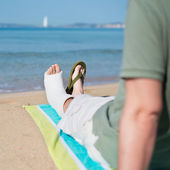 Man with Plaster relaxing on Beach — Stock Photo