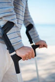 Injured Man standing with Crutches — Stock Photo