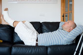 Injured Man Lying on Sofa — Stock Photo
