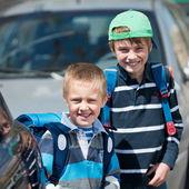 Schoolchildren outdoors — Stock Photo