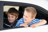 Boys in car — Stock Photo
