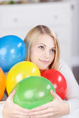 Young Thinking Woman With Colorful Balloons — Stock Photo