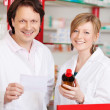 Stock Photo: Two confident pharmacists at work