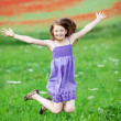 Jumping little girl — Stock Photo #25869089