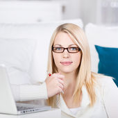Young Woman Sit On The Sofa With Laptop — Stock Photo