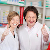 Confident Pharmacists Showing Thumbsup Sign — Stock Photo