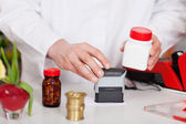 Pharmacist Stamping Bill At Pharmacy Desk — Stock Photo