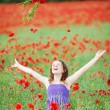 Girl throwing flowers into the air — Stock Photo