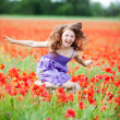 Girl in flower field — Stock Photo