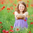 Little girl with bread — Stock Photo