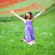 Young girl jumping for joy — Stock Photo