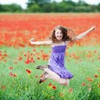 Stock Photo: Young girl jumping for joy