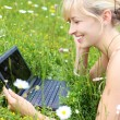 Happy woman using her notebook outdoors — Stock Photo