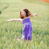 Happy carefree girl in a cornfield — Stock Photo