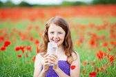Smiling girl with mineral water — Stock Photo