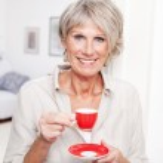 Portrait of a senior lady enjoying espresso — Stock Photo