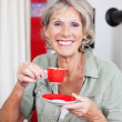 Vivacious senior woman drinking espresso — Stock Photo