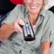 Stock Photo: Pensioner with remote control