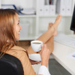 Businesswoman Having Coffee At Office Desk — Stock Photo
