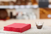Tissue Papers And Glass On Coffee Shop Table — Stock Photo