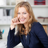 Smiling Businesswoman In Office — Stock Photo