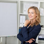 Mid Adult Businesswoman Smiling In Office — Stock Photo