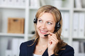 Female Customer Service Operator Using Headset — Stock Photo