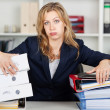 Stock Photo: Bored BusinesswomBehind Stacked Binders At Desk