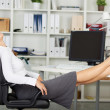 Businesswoman Relaxing On Office Chair — Stock Photo