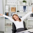 Excited Businesswoman With Arms Raised At Desk — Stock Photo