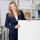 Smiling Businesswoman With Billboard In Office — Stock Photo