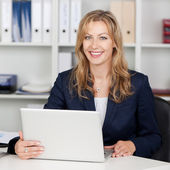 Smiling Businesswoman Using Laptop At Office Desk — Stock Photo