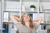 Businesswoman Relaxing At Desk — Stock Photo