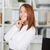 Businesswoman With Hand On Chin Looking Away — Stock Photo