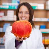 Female Pharmacist Holding Artificial Apple — Stock Photo