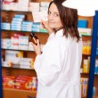 Stock Photo: Female Pharmacist Holding Medicine Bottle