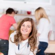 Teenage Girl Leaning On Table With Friends Working In Background — Stock Photo