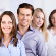 Confident Businesspeople Standing In A Row At Office — Stock Photo
