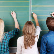 3 Teenage Students Writing On Chalkboard — Stock Photo