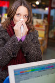 Woman With A Runny Nose In Pharmacy — Foto de Stock