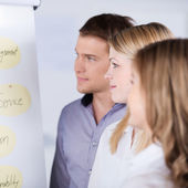 Businesspeople Looking At Flip Chart — Stock Photo