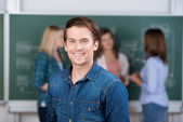 Male Student Smiling With Teacher And Classmates In Background — Stock Photo