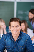Portrait Of Male Student Smiling In Classroom — Stock Photo